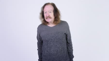 задумчивый : Senior man with mustache against white background Стоковые видеозаписи