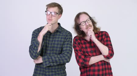 fince : Happy senior hipster man and young hipster man thinking together Stok Video