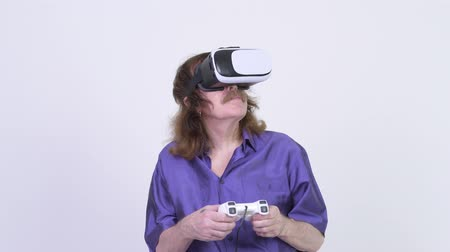 white shirt : Happy senior man playing games while using virtual reality headset Stock Footage