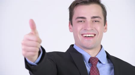 human like : Young happy handsome businessman giving thumbs up