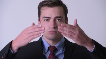 sayings : Young handsome businessman covering eyes as three wise monkeys concept Stock Footage