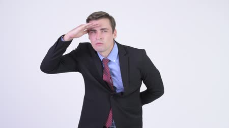 looking far away : Young handsome businessman searching something Stock Footage