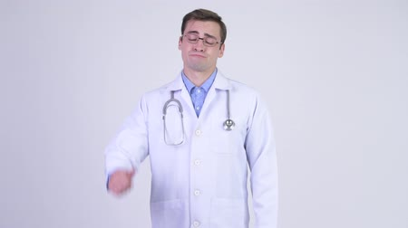 refusing : Young sad man doctor giving thumbs down