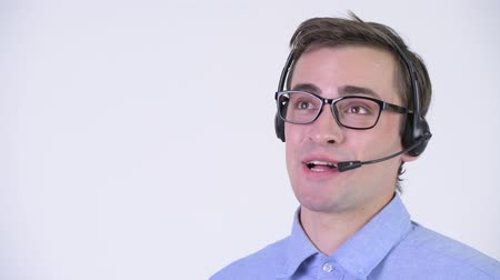 representante : Young happy handsome businessman as call center representative