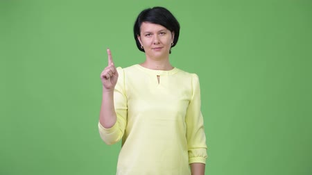 fingers : Beautiful businesswoman with short hair pointing up