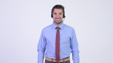representante : Young happy Hispanic businessman as call center representative