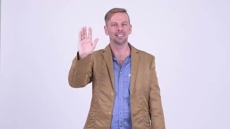 do widzenia : Happy blonde casual businessman waving hand