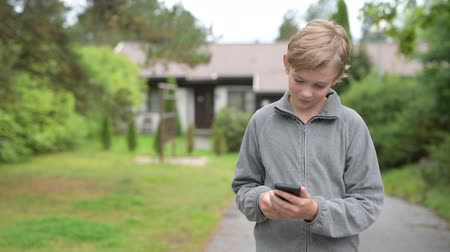 пригородный : Young Boy Using Phone And Taking Selfie At Home Outdoors