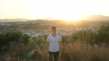 fince : Young Handsome Tourist Man Looking Around And Smiling On Top Of The Hill