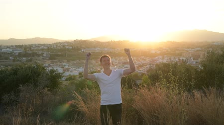 malaga : Young Happy Tourist Man With Arms Raised On Top Of The Hill