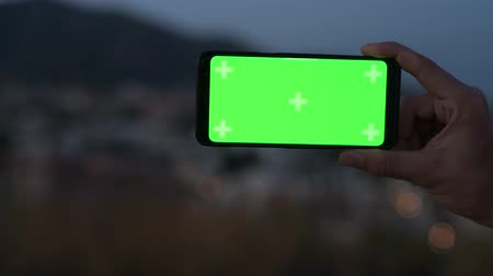 malaga : Hand Of Young Man Using Phone In Nature At Night