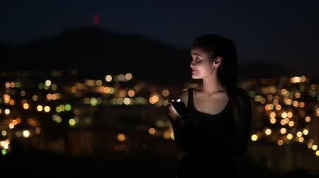 malaga : Young Happy Asian Tourist Woman Using Phone Against View Of The City Lights At Night