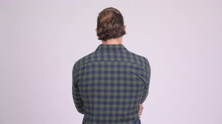 anız : Rear view of hipster man thinking against white background Stok Video