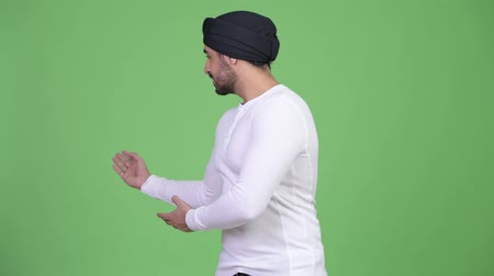 sikhism : Young happy bearded Indian man showing something Stock Footage