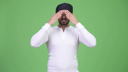 sayings : Young handsome bearded Indian man covering eyes as three wise monkeys concept