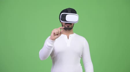 sikhism : Young bearded Indian man using virtual reality headset