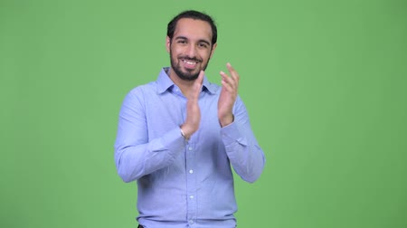 ovation : Young happy bearded Indian businessman clapping hands Stock Footage