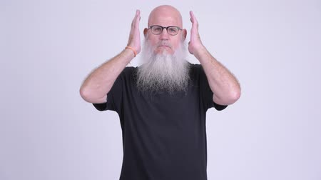 sayings : Mature bald bearded man covering ears as three wise monkeys concept