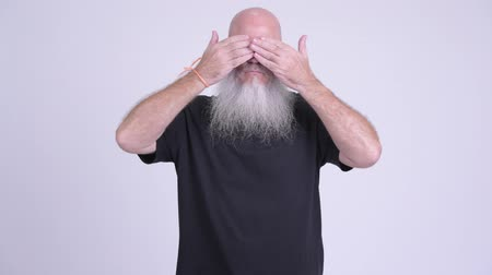 olgun : Mature bald bearded man covering eyes as three wise monkeys concept Stok Video