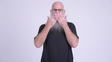 sayings : Mature bald bearded man covering mouth as three wise monkeys concept Stock Footage