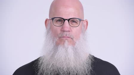 bilge : Mature bald bearded man doing three wise monkeys concept Stok Video