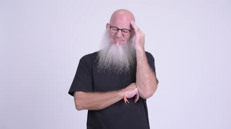 calvizie : Stressed mature bald bearded man having headache Filmati Stock