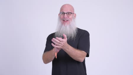 ovation : Happy mature bald bearded man clapping hands
