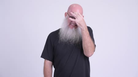 ignore : Stressed mature bald bearded man not wanting to see something Stock Footage