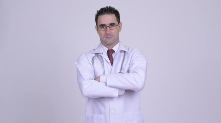 hanedan arması : Happy handsome man doctor wearing eyeglasses with arms crossed