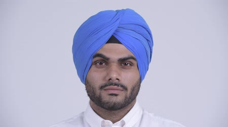 frizura : Face of young bearded Indian Sikh man wearing turban Stock mozgókép