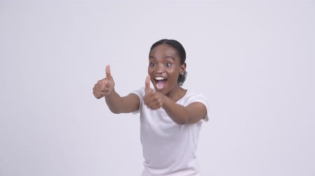 縛ら : Happy young beautiful African woman giving thumbs up and looking excited 動画素材