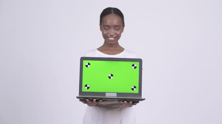 south african : Happy young beautiful African woman thinking while showing laptop Stock Footage