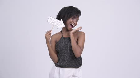bastante : Happy young drunk African woman with Not Drunk Enough paper sign Stock Footage