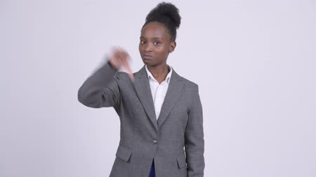 неправильно : Young angry African businesswoman giving thumbs down