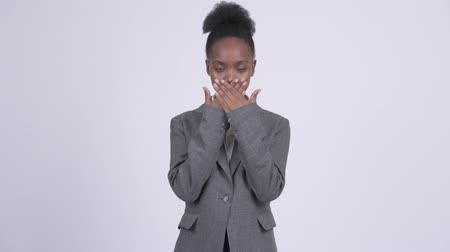 sayings : Young African businesswoman covering mouth as three wise monkeys concept
