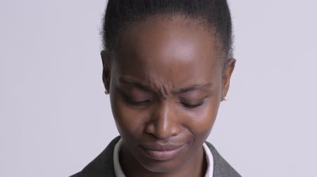 south african : Face of young sad African businesswoman depressed and crying