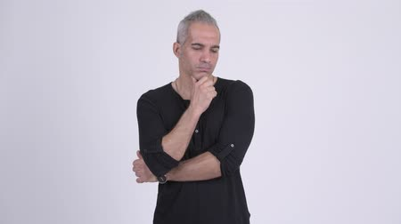 negatividad : Serious Persian man thinking against white background