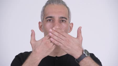 bilge : Handsome Persian man covering mouth as three wise monkeys concept Stok Video