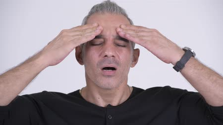 anız : Stressed Persian man having headache against white background