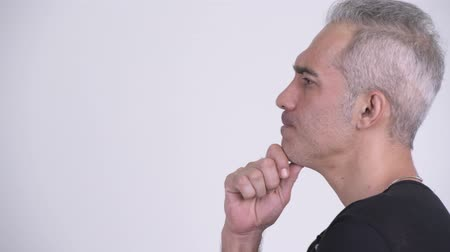 ponderar : Profile view of handsome Persian man thinking against white background Stock Footage