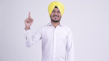 sikhism : Happy bearded Indian Sikh businessman pointing up Stock Footage