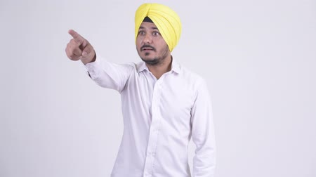 sikhism : Bearded Indian Sikh businessman pointing finger Stock Footage