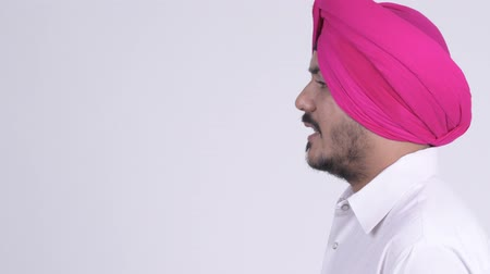 sikhism : Closeup profile view of bearded Indian Sikh man with turban talking