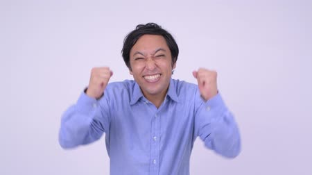 kabarık : Happy Japanese businessman looking excited with fists raised