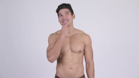 férfias : Happy young handsome muscular shirtless man thinking Stock mozgókép