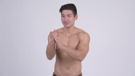ovation : Happy young handsome muscular shirtless man clapping hands