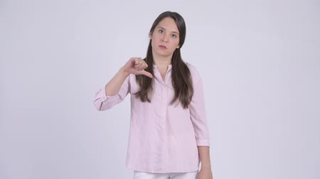 refusing : Young stressed multi-ethnic businesswoman giving thumbs down Stock Footage