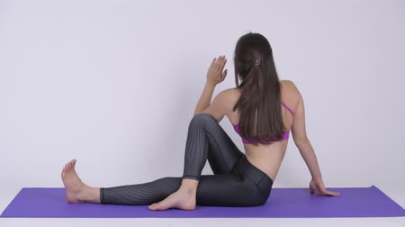 bílý : Young beautiful multi-ethnic woman doing Seated Twist yoga pose