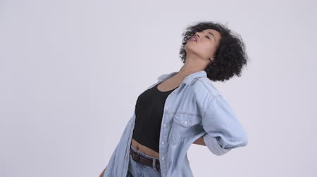 denim : Young stressed African woman having back pain Stock Footage