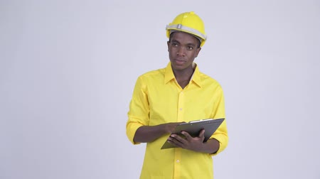 direkt : Young happy African businessman as engineer directing while holding clipboard